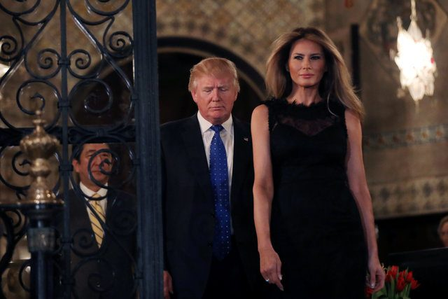 U.S. President Donald Trump, First Lady Melania Trump and Japanese Prime Minister Shinzo Abe (L) walk to pose for a photograph before attending dinner at Mar-a-Lago Club in Palm Beach, Florida, U.S., February 11, 2017. REUTERS/Carlos Barria