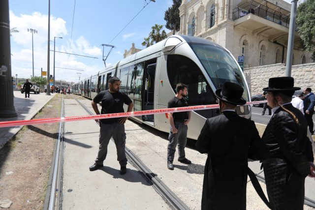 Israeli policemen block a road where the light train passes following a stabbing attack just outside Jerusalem's Old City, according to Israeli police April 14, 2017. REUTERS/Ammar Awad