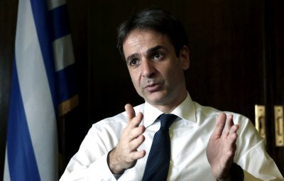 "Greek Administrative Reform Minister Kyriakos Mitsotakis speaks during an interview with the Associated Press in Athens, Tuesday, April 8, 2014. Mitsotakis said years of austerity have left Greece with about 200,000 fewer civil servants than before its debt crisis erupted in late 2009. He added that  the country has made significant overall progress, which should allow it to tap international capital markets ""in the foreseeable future."" (AP Photo/ Petros Giannakouris)"