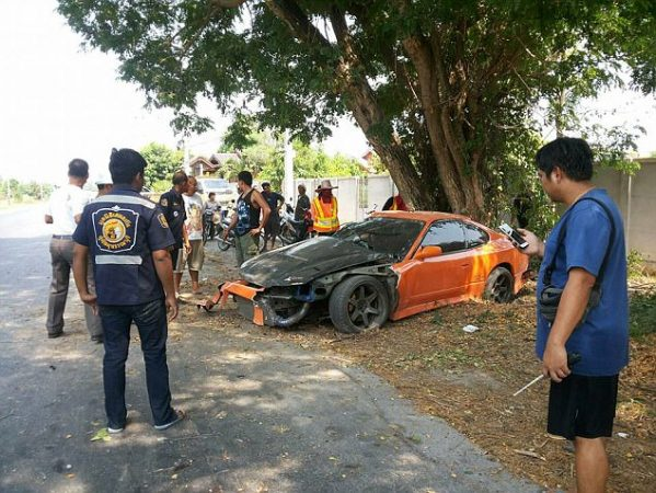 NEWS COPY - WITH PICTURES A demob-happy monk borrowed his friend's sports car to celebrate and crashed it - into a TREE. Thapanat Chaiyasut, 31, was just one day from leaving the strict monkhood when he took a pal's orange Nissan Silvia S15 for a spin yesterday (Tue). But after leaving the driveway he accelerated away before minutes later clipping a tree and spinning out of control in Suphanburi, central Thailand.  Thapanat - still wearing orange robes when he was found in the driver's seat - suffered a broken arm and cuts to his leg while passenger Boonyarit Puengchareon, 19, was unconscious. Police said that Thapanat and his passenger had both been taken to hospital where they were stable after the ''Fast and Furious'' style crash. Police captain Mr. Kornvit Meedee from the Samshook district station said the monk had been ''speed testing'' the vehicle.  He said: ''Police arrived at the scene with ambulance staff from the Samshook hospital and we found the car crashed with Phra Thapanat inside.  ''The sports car had been modified. It hit a tree at the side of the road and crashed. The front window was smashed and a front wheel had blown out.'' Pol Cpt Meedee said officers and the ambulance team immediately took the injured men to the hospital. The driver was not arrested or charged with any offences.  He added: ''They investigated and found out that Pra Tapanatchaisut's friends drove the car to see him and Pra Tapanatchaisut borrowed the car to drive on the road to test how fast the car is. ''Pra Tapanatchaisut drove as fast as he can until he hit the tree very hard. Pra Tapanatchaisut was supposed to leave the temple the next day on 26th April but the accident happened just a day before.'' A spokesman for the Smerkan Supanburi foundation said the believed the car was a Nissan Silvia S15 and its bodywork been modified.  They added: ''It was too fast for the monk to handle. The car is like the same one from the Fast and Furious movies.'' ENDS