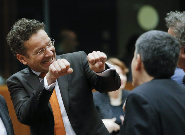 epa05200343 President of Eurogroup, Dutch Finance Minister Jeroen Dijsselbloem (C) gestures with his hands in the direction of Greek Finance Minister Euclid Tsakalotos during an Ecofin Finance ministers meeting in Brussels, Belgium,  08 March 2016. The Council will aim to reach a political agreement on the proposed amendment to the directive on mandatory exchange of information in the field of taxation.  EPA/OLIVIER HOSLET