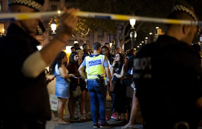 SPAIN, Barcelona: Police officers evacuate people from the area as they take security measures at the area after a van plowed into the crowd, injuring several people in Barcelona, Spain on August 17, 2017. A driver deliberately rammed a van into a crowd on Barcelona's most popular street on August 17, 2017 killing at least 13 people before fleeing to a nearby bar, police said. Officers in Spain's second-largest city said the ramming on Las Ramblas was a terrorist attack.  (AAP Image/NEWZULU/De Vallier Lino).