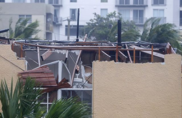 epa06197214 A home with severe roof damage after the full effects of Hurricane Irma struck in Miami, Florida, USA, 10 September 2017. Many areas are under mandatory evacuation orders as Irma Florida. EPA/ERIK S. LESSER